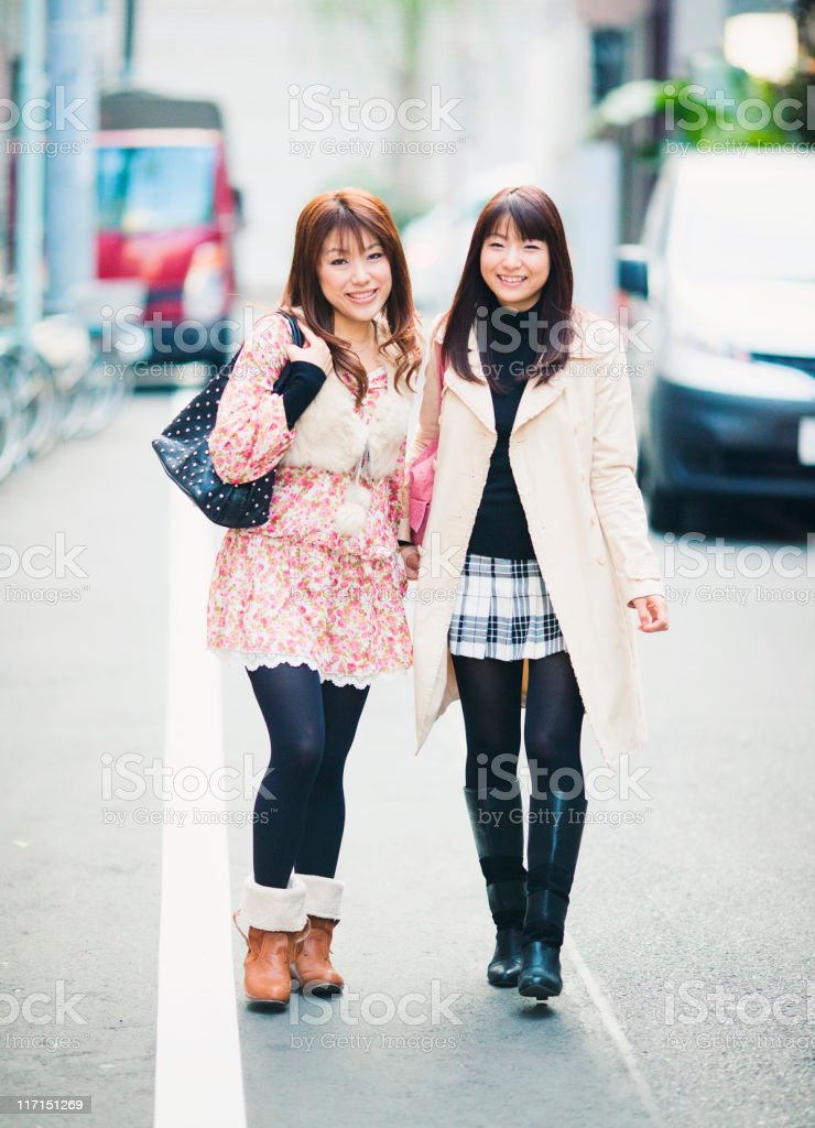 happy girlfriends in tokyo royalty-free stock photo