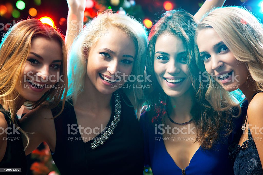 Happy girls at a Christmas party stock photo
