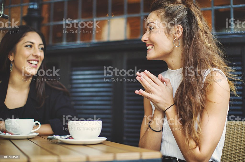 Happy girls at coffee shop in London stock photo