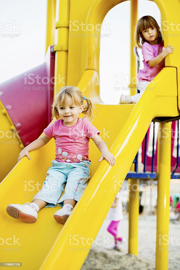 Happy girls enjoying in the Playground. royalty-free stock photo