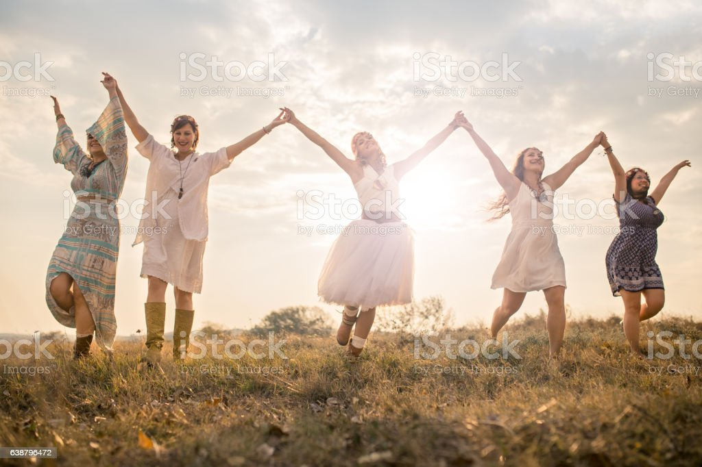 Happy girls having good fun time outdoors. stock photo