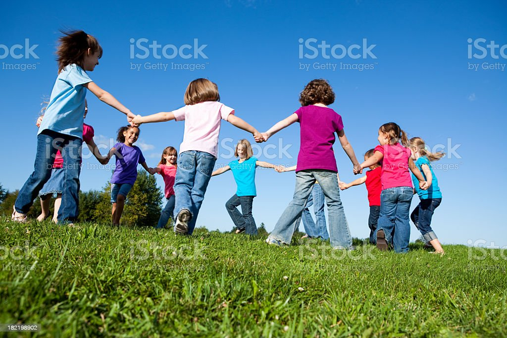 Happy Girls Holding Hands and Spinning in a Circle royalty-free stock photo