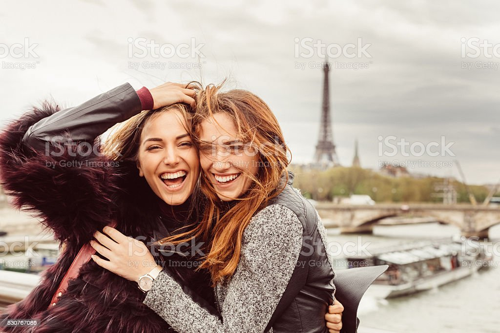 Happy girls in Paris against the Eiffel tower stock photo