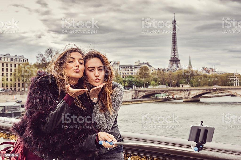 Happy girls in Paris taking selfie stock photo