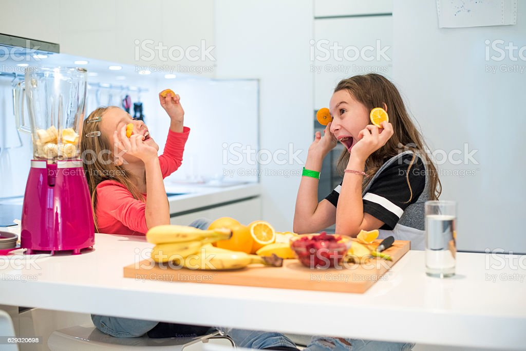 Happy girls in the kitchen stock photo
