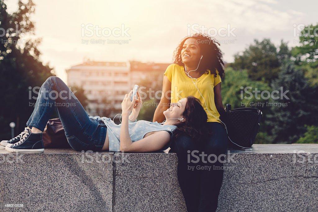 Happy girls on a city break stock photo