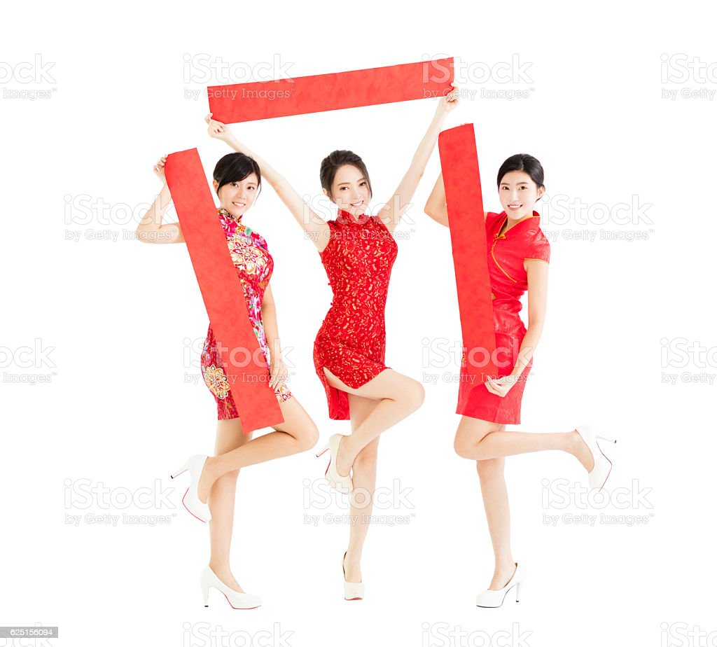 happy girls showing Spring festival couplets for chinese new yea stock photo