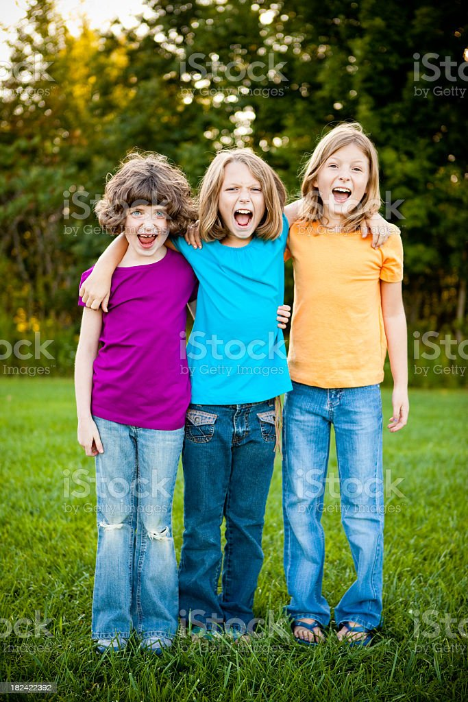 Happy Girls Yelling and Laughing Together Outside royalty-free stock photo