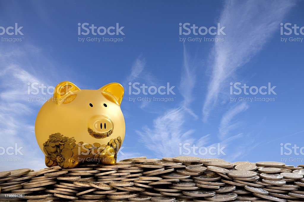 Happy Gold Piggy Bank on pile of Coins royalty-free stock photo