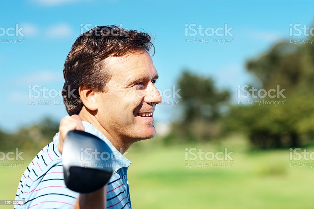 Happy golfer holding golf club over his shoulders royalty-free stock photo