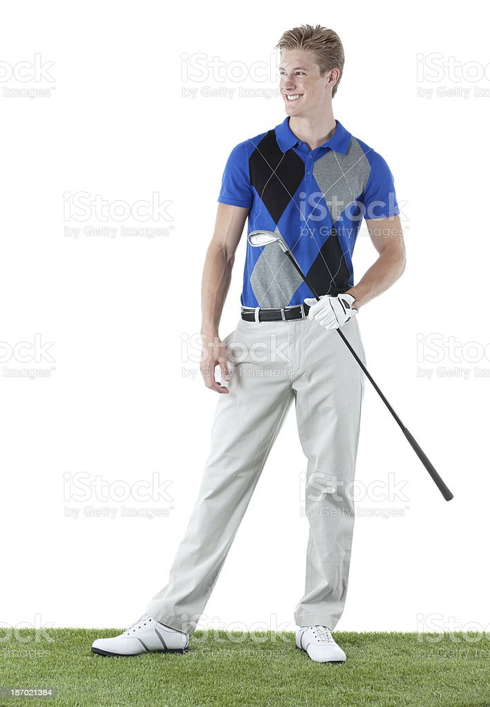 Happy golfer standing in golf course royalty-free stock photo