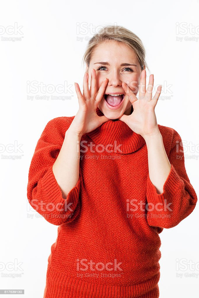 happy gorgeous young woman using her hands to communicate stock photo