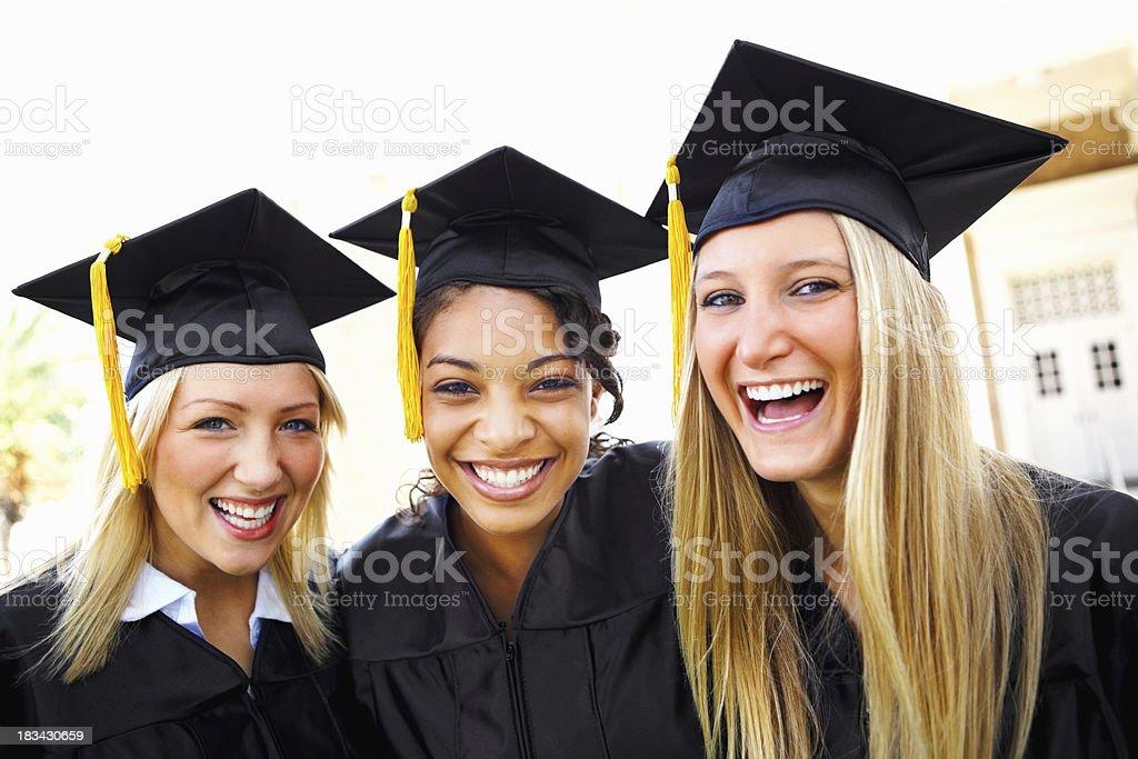 Happy graduating girls royalty-free stock photo