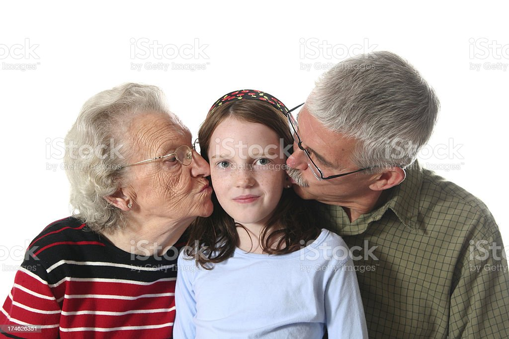 Happy Grandchild Getting Kisses royalty-free stock photo