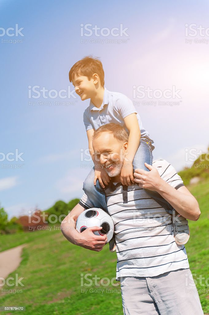 Happy grandfather and child entertaining together stock photo