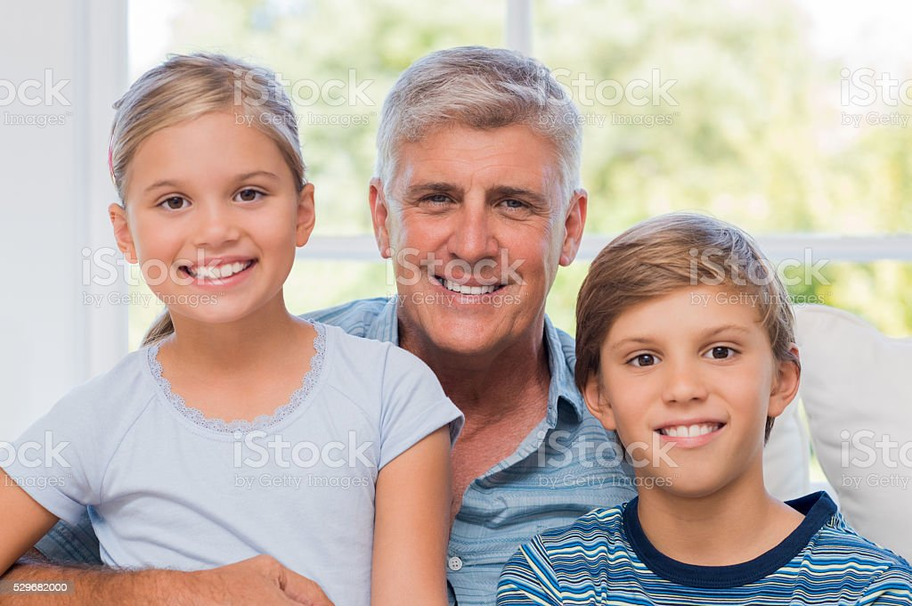 Happy grandfather and grandchildren stock photo