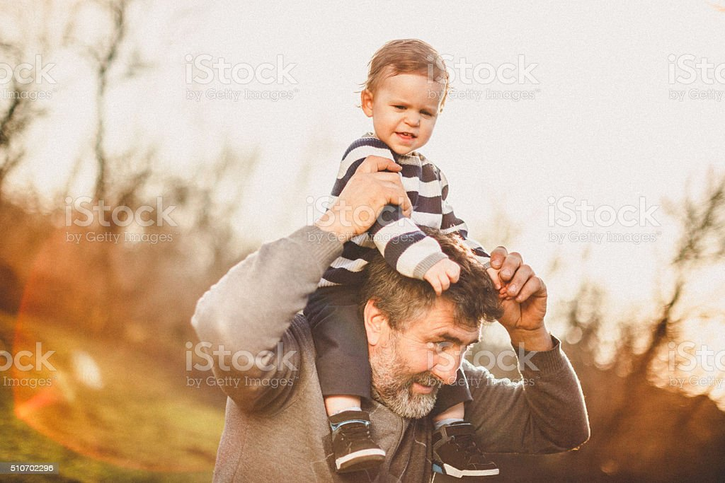 Happy grandfather and grandson stock photo