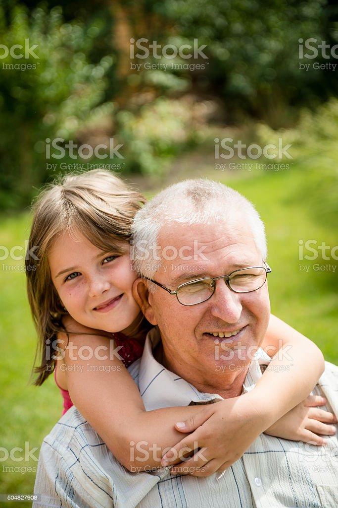 Happy grandfather with grandchild stock photo
