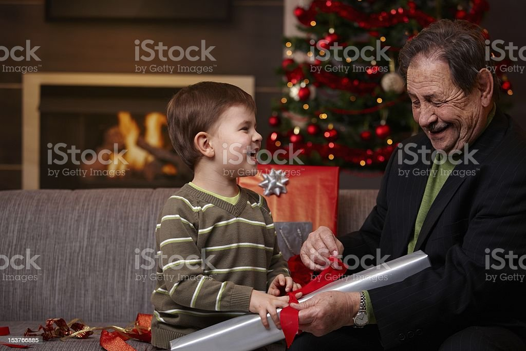 Happy grandfather with grandson at christmas royalty-free stock photo