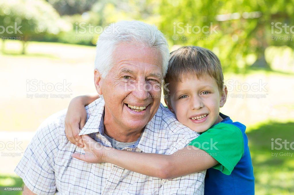 Happy grandfather with his grandson stock photo