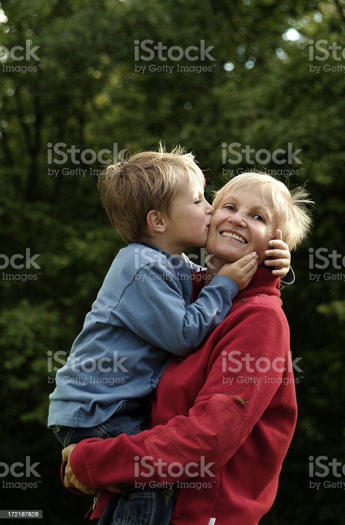 A happy grandma holding her grandson royalty-free stock photo