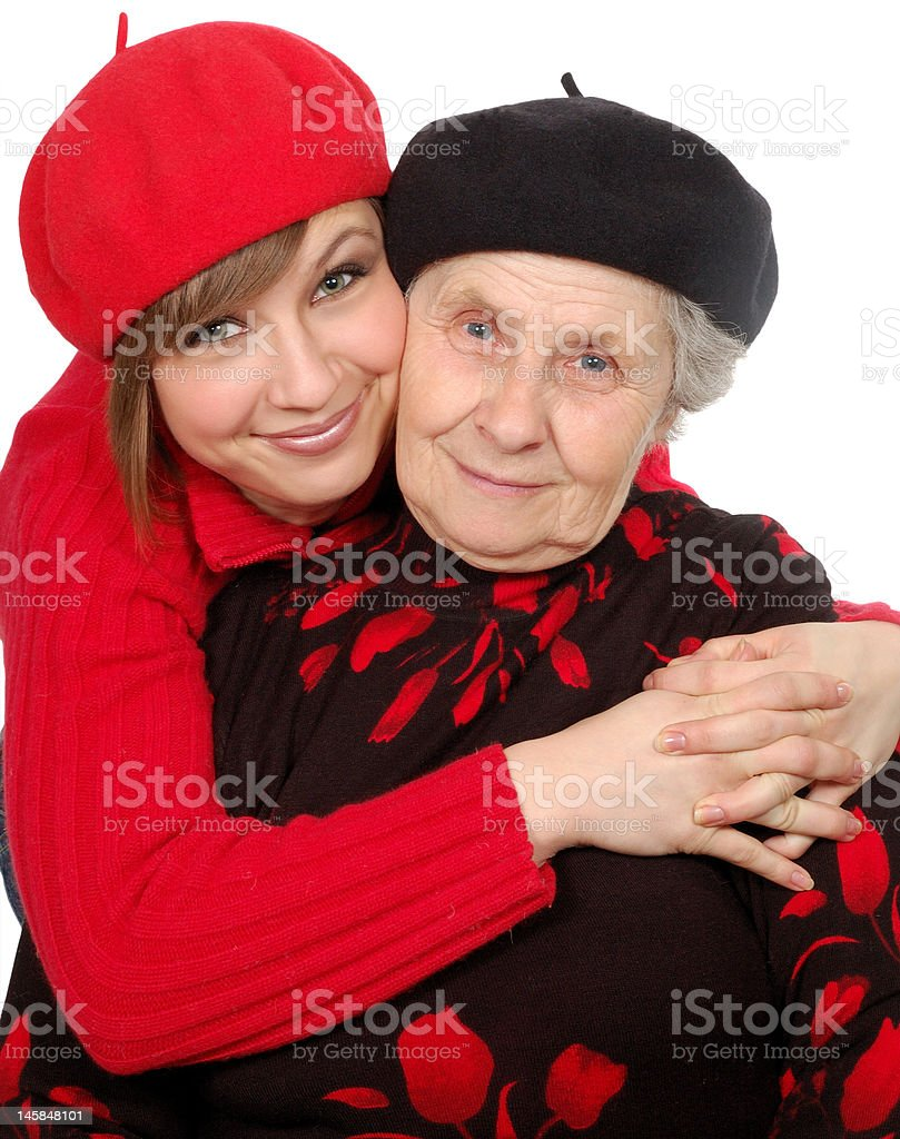 happy grandmother and granddaughter with berets royalty-free stock photo