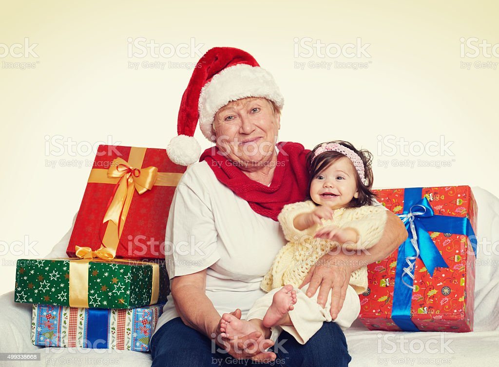 happy grandmother and granddaughter with christmas box gift stock photo