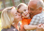 Happy grandparent with grandson embracing