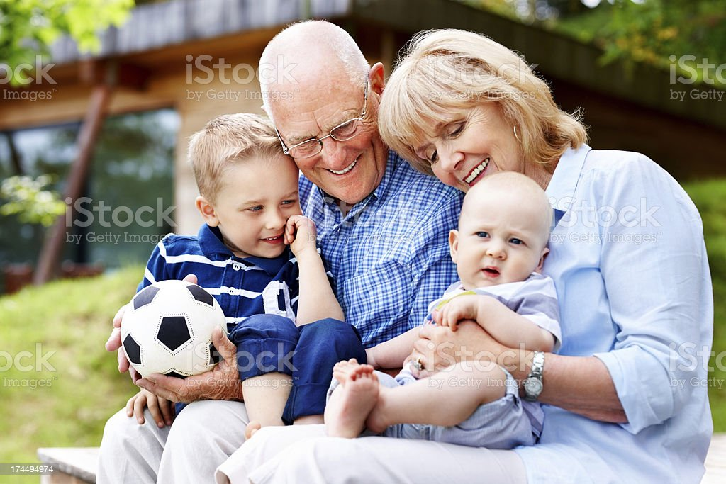Happy grandparents and grandchildren - Outdoors royalty-free stock photo