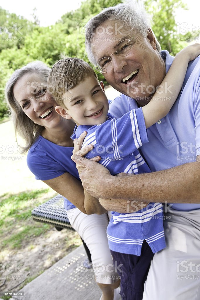 Happy Grandparents Outside With Their Grandson royalty-free stock photo