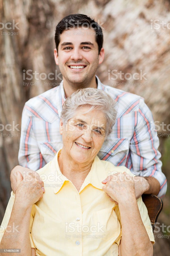 Happy grandson and grandmother royalty-free stock photo