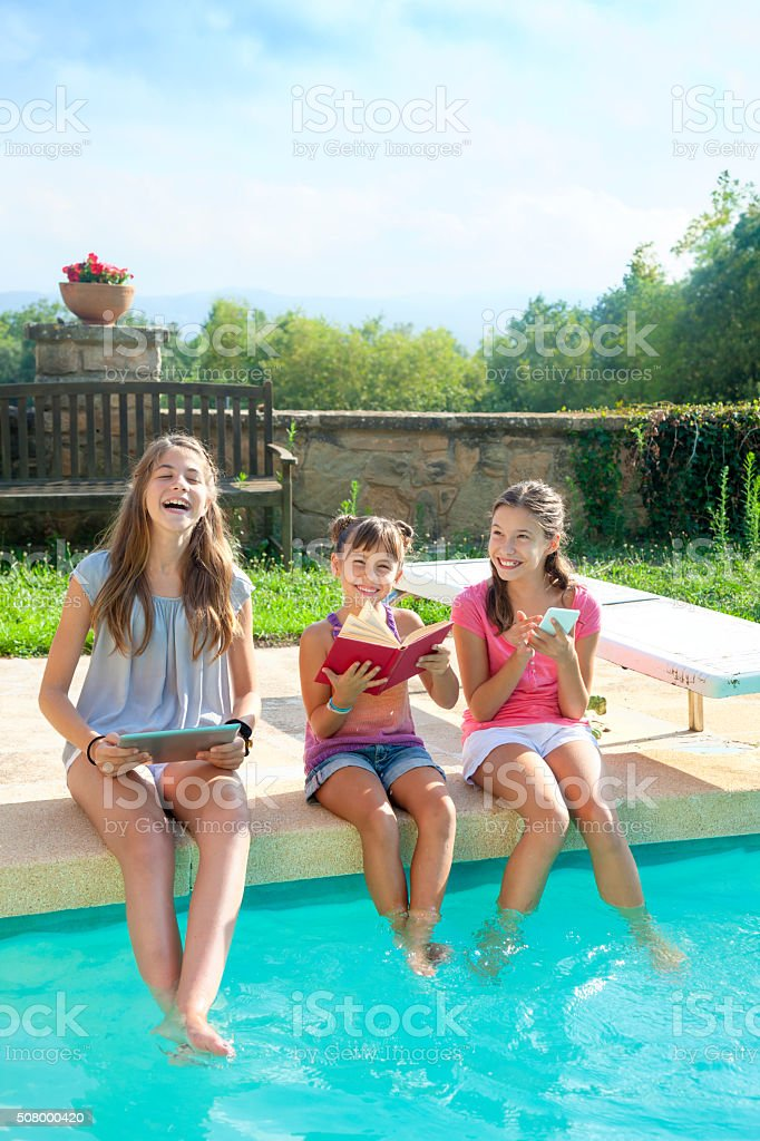 Happy group de child playing on the swmming pool stock photo