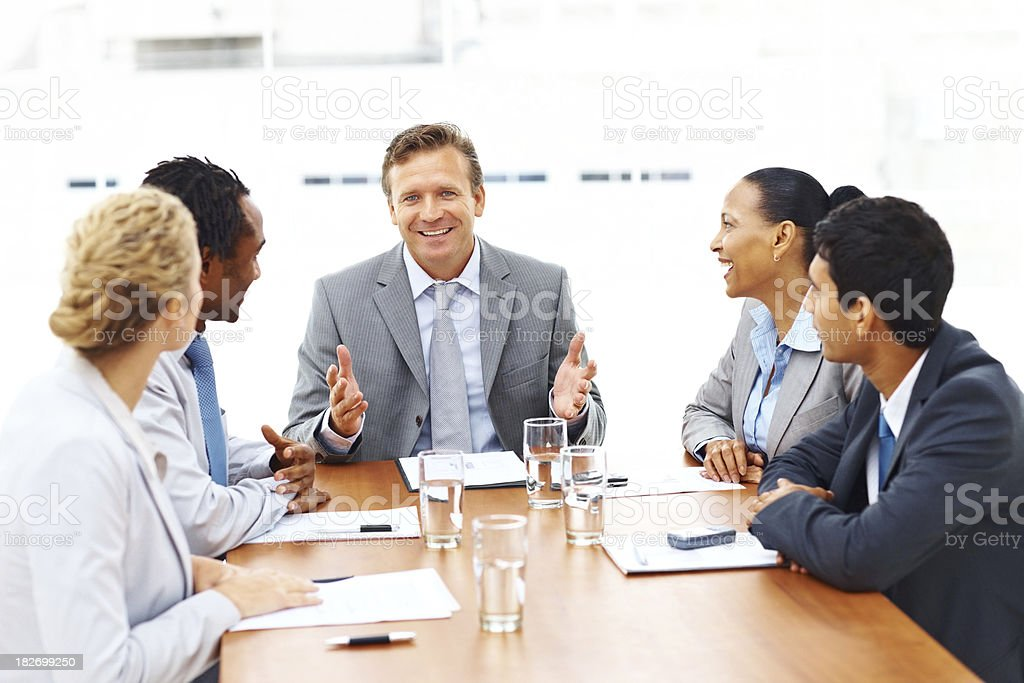Happy group of business people sitting at a meeting royalty-free stock photo