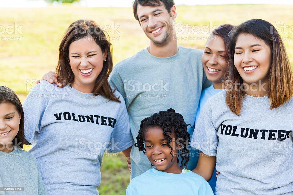 Happy group of diverse volunteers stock photo