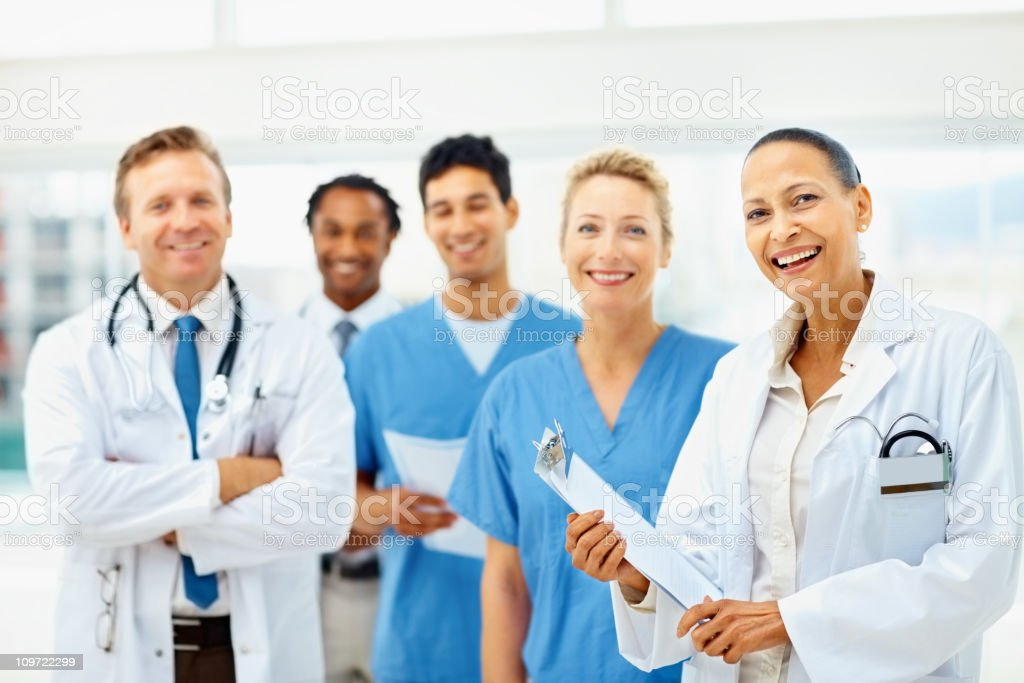 Happy group of doctors smiling royalty-free stock photo