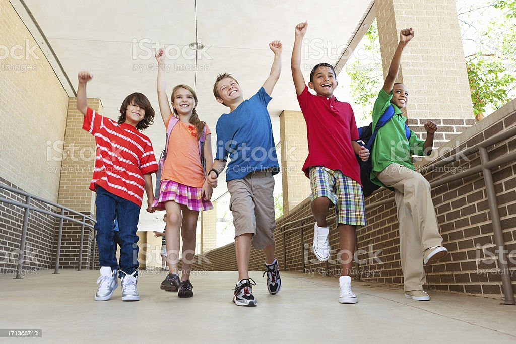 Happy group of elementary students expression after school royalty-free stock photo