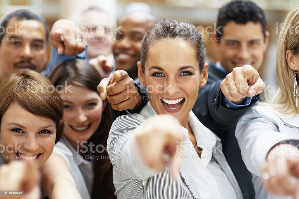 Happy group of executives pointing at you stock photo