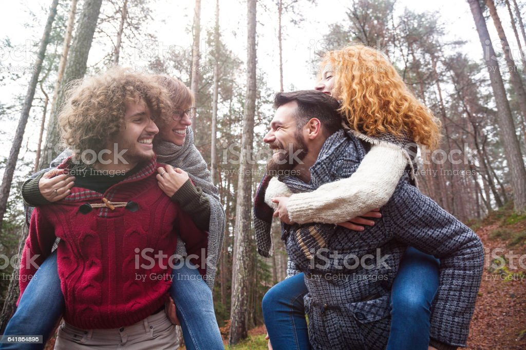 Happy Group of friend walking into wood stock photo