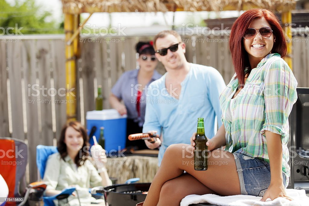 BBQ: happy group of friends at an outdoor tailgate party stock photo