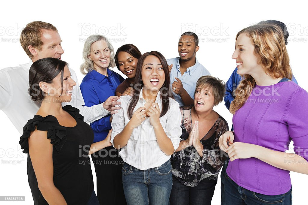 Happy Group of Friends Congratulating Young Woman royalty-free stock photo
