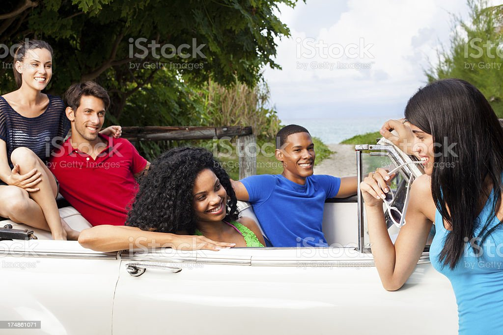 Happy group of friends hanging out royalty-free stock photo