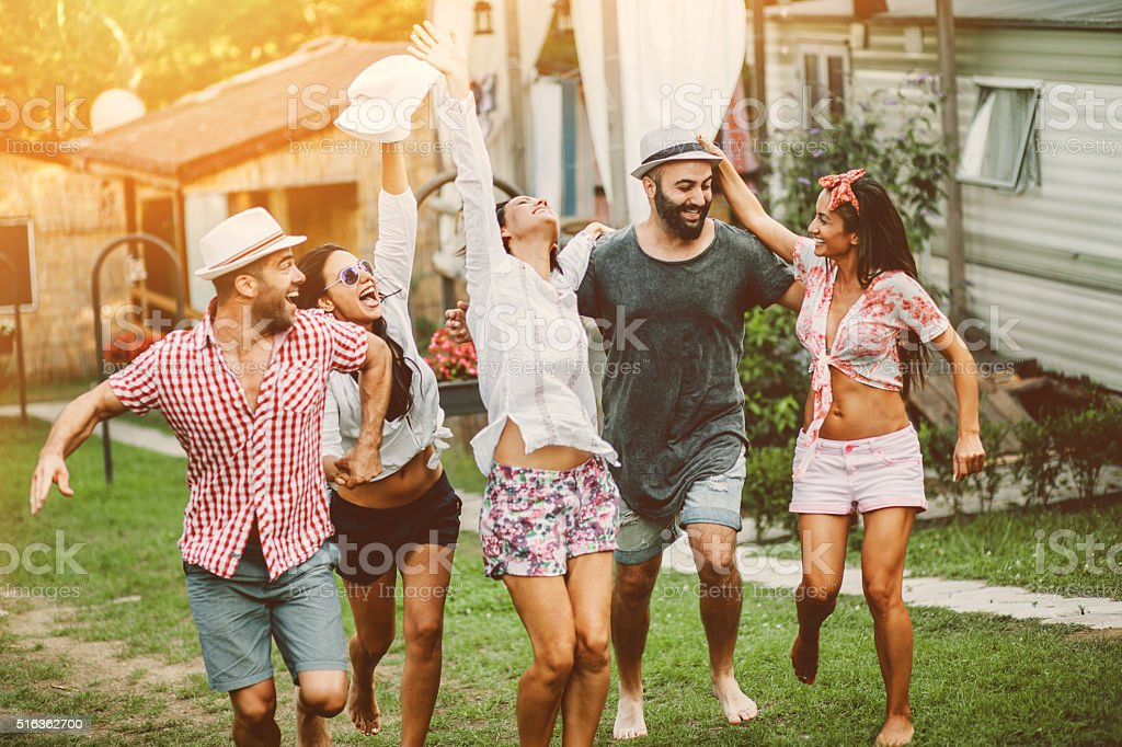 Happy group of friends in the summer stock photo