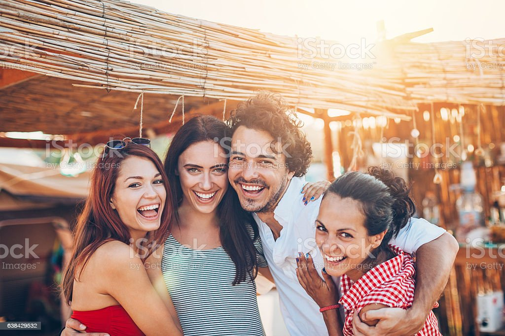 Happy group of friends on a summer camp stock photo