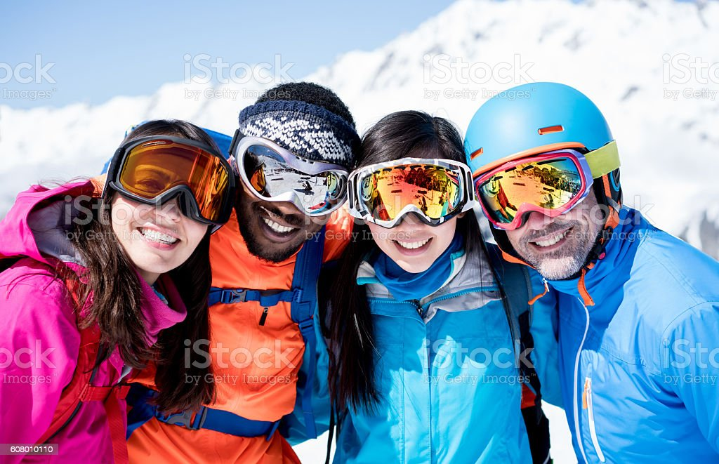 Happy group of friends skiing stock photo