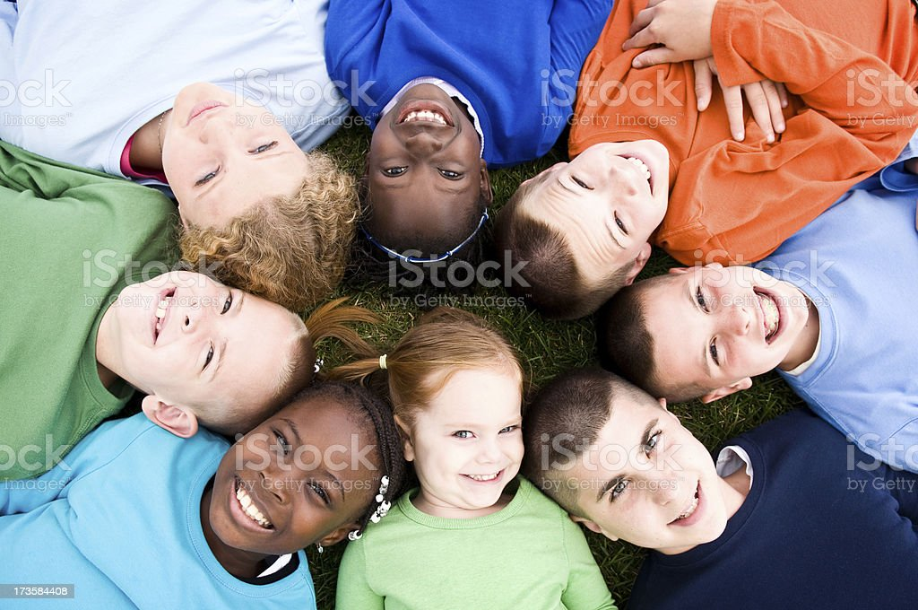 Happy Group of Kids Lying in a Circle royalty-free stock photo