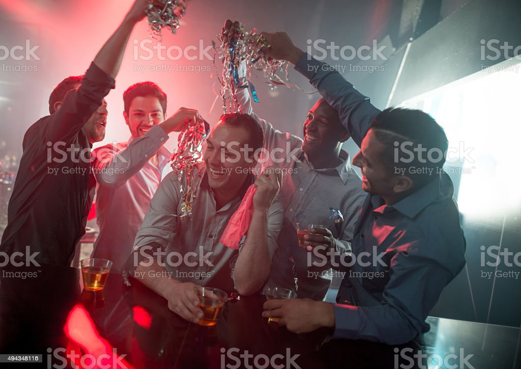 Happy group of men at a bachelor party stock photo