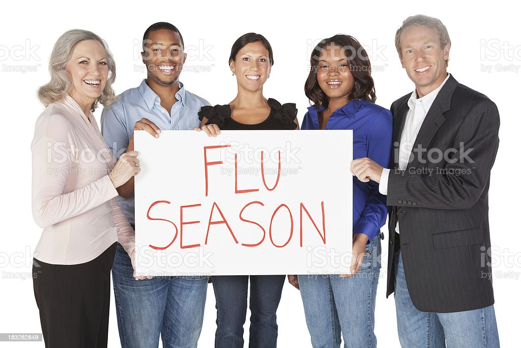 Happy Group of People Holding Flu Season Sign royalty-free stock photo