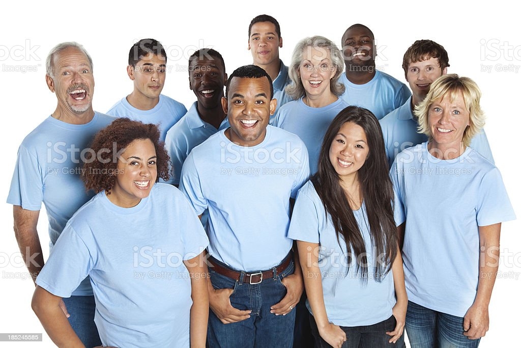 Happy group of people laughing together, all in blue shirts stock photo