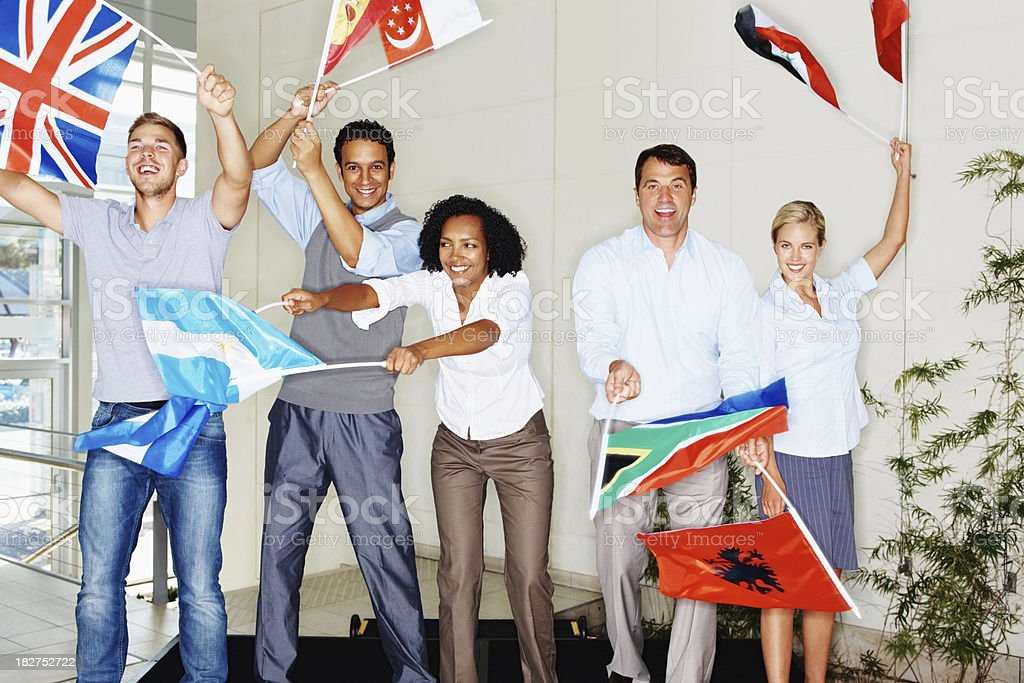 Happy group of people waving different country flags royalty-free stock photo