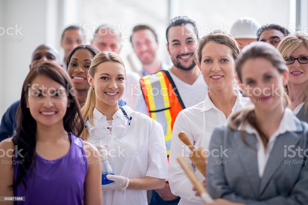 Happy Group of Professional Workers stock photo